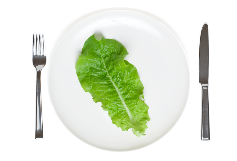 Single lettuce leaf on a plate