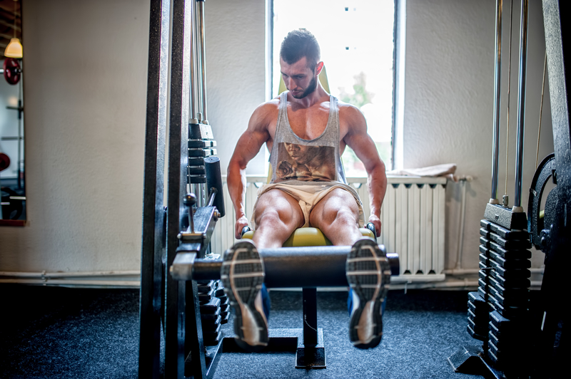 bodybuilder working out and training at the gym, legs and feet p